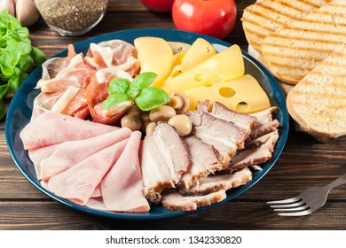 Cold meat platter with ham, prosciutto, baked pork belly and cheese. Charcuterie assortment