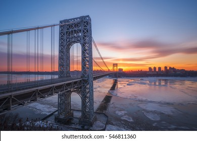 Cold morning at George Washington Bridge with ice in the Hudson River