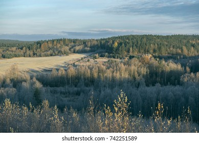 Cold morning over the frozen fields and forrest on the very north of Russia. Late fall.