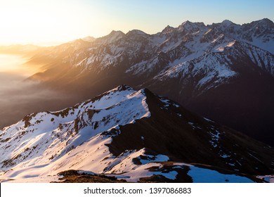 A cold morning from the top of the Peak Chavalatsch in the Stelvio Nationalpark. Beautifull view to the mountains over prato allo stelvio at sunrise.