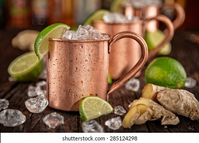 Cold Moscow Mules - Ginger Beer, lime and Vodka on bar