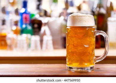 cold mug of beer in a bar