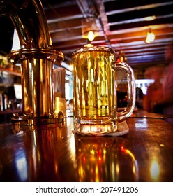 A cold pint of beer on a bar
