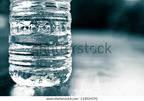 Cold plastic bottle of water. drought, thirst, hydration, natural resource conservation and recycling concept.