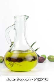 Cold pressed, extra virgin olive oil from Spain with a fresh crop of autumn picked green and black olives. On white.