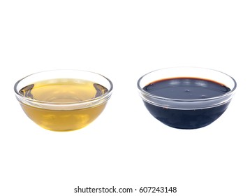 Cold pressed organic extra virgin olive oil and balsamic vinegar of Modena in bowls isolated on white background