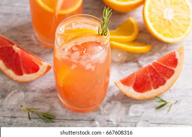 Cold and refreshing citrus cocktail with grapefruit and orange