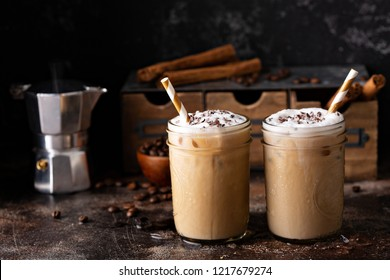 Cold refreshing iced coffee in mason jars