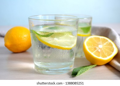 Cold refreshing lemonade with fresh mint and lemon in a glass Summer drink