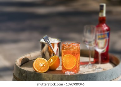 Cold and refreshing summer cocktail. Drinks and hospitality concept. image with selective focus. decanter of cocktail in the front, other bottles are behind in the background.