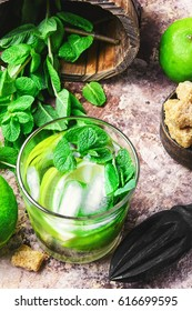 Cold refreshing summer cocktail Mojito with lime and mint
