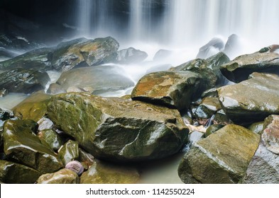 cold river waterfall cascade falling down on stones in national reserve park Thailand
