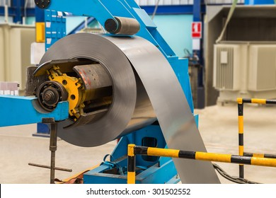 Cold rolled steel coil on decoiler of machine in metalwork manufacturing