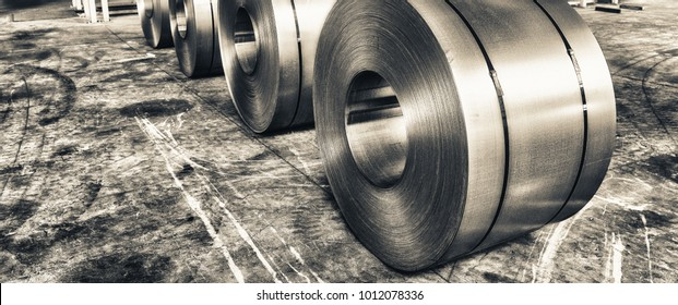 Cold rolled steel coils in storage area ready to feed to machine in metalwork manufacturing.