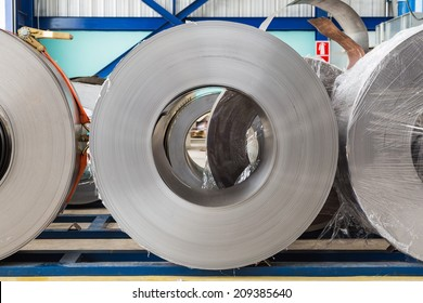 Cold rolled steel coils in storage area ready to feed to machine in metalwork manufacturing
