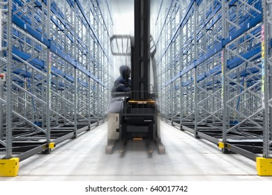 Cold room storage. Refrigeration and freezing warehouse with stacker truck inside moving.
