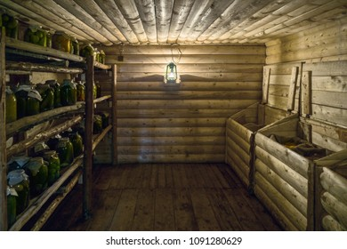 Cold rural wooden pantry with jars on shelves and cereals in chests. Lantern lights on the wall. Horizontal shot