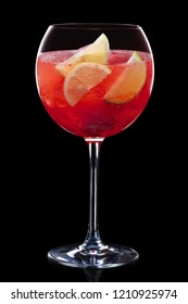 Cold sangria in a wine glass isolated on black
