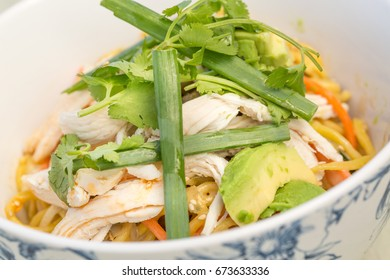 Cold sesame noodles with chicken, cilantro, carrots, green onions and avocado