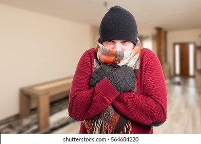 Cold sick man with influenza dressed in warm clothes inside the house with copy space