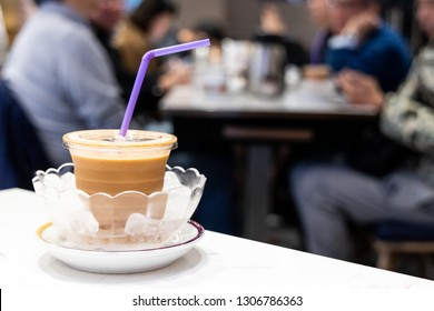 Cold silky smooth milk tea infused with ice in bowl, popular drinks served in restaurants in Hong Kong
