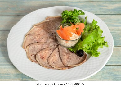 Cold snack - beef tounge with horseradish.