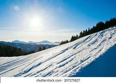 cold snow ski slope on Alps mountain in Portes du Soleil region, Morzine - Avoriaz, France