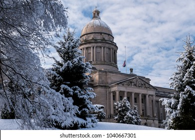 A cold and snowy winter afternoon looking towards the historic Beaux Arts styled state capitol building in Frankfort, Kentucky.