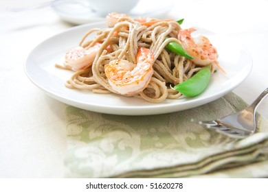 Cold soba noodle salad with shrimp, peas, and carrots