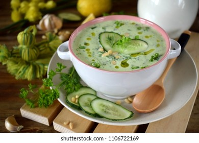 Cold soup Tarator with kefir, cucumbers and pine nuts in a ceramic tureen. Bulgarian cuisine meal