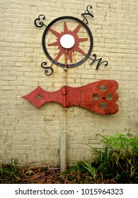 Cold Spring, New York: Vintage weathervane propped against a yellow brick wall in the Hudson Valley town.