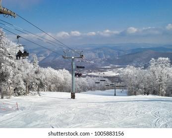 Cold start - frosty ski scene and lift