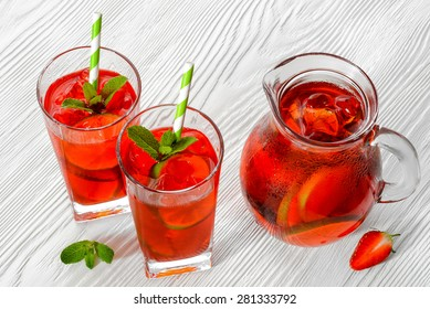Cold strawberries drinks with strawberry slices and mint