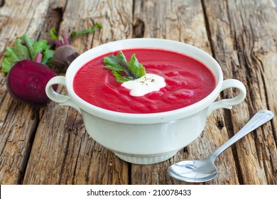 Cold summer Beets soup on te wooden background