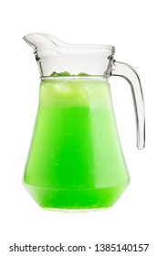 Cold, summer drink from tarragon, mint in a glass jug on a white isolated background.