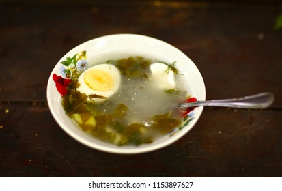 cold summer russian sorrel shchi soup close up photo on wooden table background