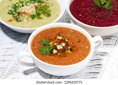 cold vegetable soups in assortment on white table, closeup