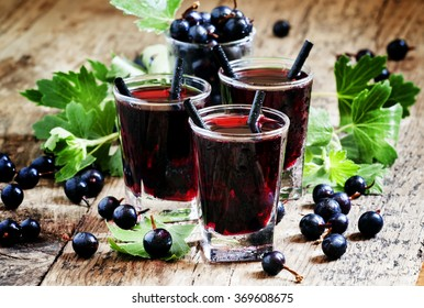 Cold vodka with blackcurrant juice and fresh berries, selective focus