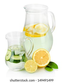 Cold water with lemon, cucumber and ice in pitchers isolated on white
