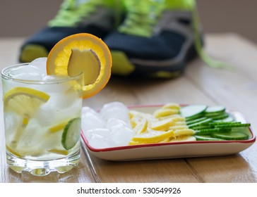 Cold water with lemon, ginger, orange and cucumber. Fitness Accessories. Healthy lifestyle concept.