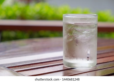 Cold water on wooden​ table​ and nature background​