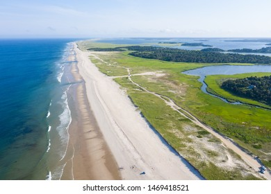 The cold waters of the Atlantic Ocean bathe a scenic beach on Cape Cod, Massachusetts. This beautiful area of New England, not too far from Boston, is a popular summer vacation destination.