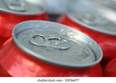 Cold wet cans of soda or beer