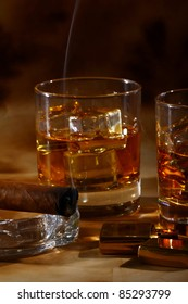 Cold whiskey  and cigar against ancient background