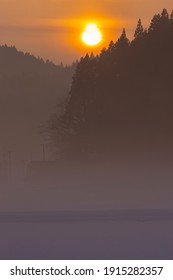 Cold winter sunrise and morning haze