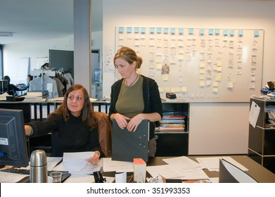 Coldrerio, Switzerland - 21 october 2002: People working at the office of Hugo Boss industry at Coldrerio on the italian part of Switzerland