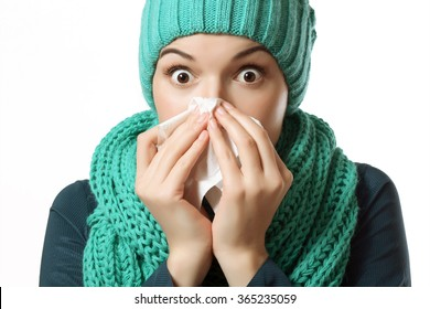 colds, flu, girl blowing your nose into a tissue