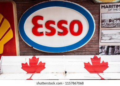 COLDWATER, ONTARIO/CANADA - JULY 23, 2018: An Esso gas sign with two maple leafs on the side of one of the old buildings on the Main Street of this quirky town.
