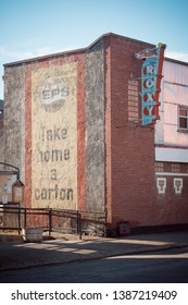 Coleman, Alberta/Canada - April 20th 2019: A vintage movie theater still has its original Pepsi advertising painted on the side of the building in the old mining town of Coleman.
