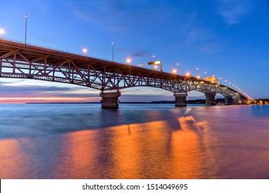 Coleman Bridge - A Summer sunset view of George P. Coleman Memorial Bridge, the largest double-swing-span bridge in U.S., crossing over York River at Yorktown, Virginia, USA.
